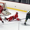 BRYAN EATON/Staff photo. A shot by Pentucket's Cam Smith goes wide past the Amesbury net.