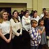 BRYAN EATON/Staff photo. Amesbury High School's Rhythmics sing the National Anthem after students from the other public schools including the Amesbury Innovation High School led the Pledge of Allegiance.