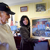 BRYAN EATON/Staff Photo. Newburyport resident and Vietnam War veteran Bud Smith presented Newburyport Mayor Donna Holaday a painting he did of the Veterans Monument in Brown Square across from city hall.