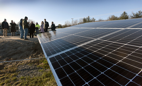 BRYAN EATON/Staff Photo. Officials gathered for a ribbon cutting of the solar farm at South Hunt Road in Amesbury on Friday afternoon. The facility, owned by Keararge Energy, has over 11,000 solar panels and will generate 5.2 megawatts of electricty per year.