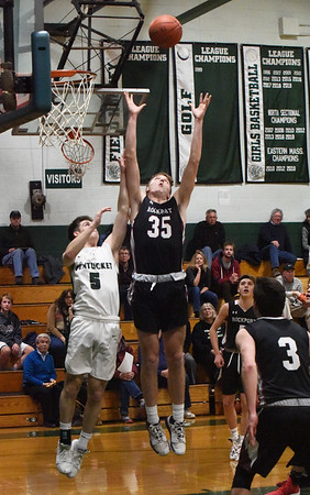 BRYAN EATON/Staff photo. Owen Kamuda and Rockport's Gavyn HIllier go for a Pentucket rebound.