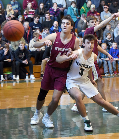 BRYAN EATON/Staff Photo. Parker McLaren and Pentucket's Peter Cleary collide as the ball gets away.