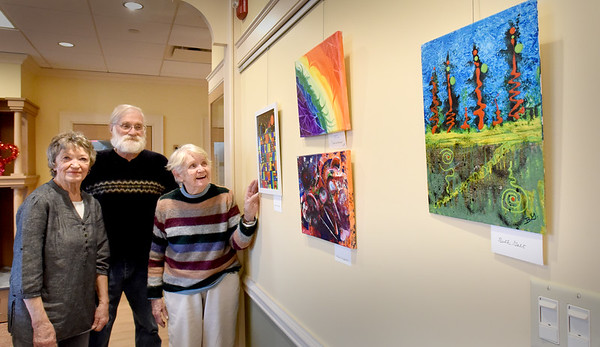 BRYAN EATON/Staff Photo. Abstract art instructor Andrea Alukonis, left, with students Bruce Campbell and Nancy Evans finished hanging an art dilsplay at the Newburyport Senior and Community Center on Tuesday. The class, which meets on Thursdays, is having a reception of their work Wednesday January 15 at 2:00 p.m. with the public welcome and refreshments served.
