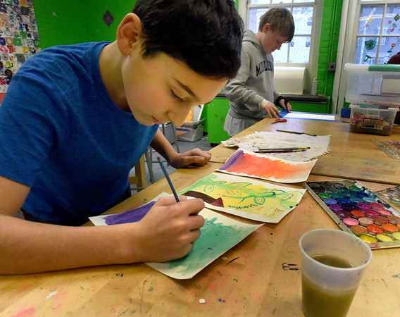 """BRYAN EATON/Staff Photo. Jared Newman, 11, illustrates his fictitious book """"Abbey and the Beanstalk"""" with watercolors on Friday. He was in the artroom of the Newburyport Rec Center in the old Brown School."""