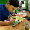 "BRYAN EATON/Staff Photo. Jared Newman, 11, illustrates his fictitious book ""Abbey and the Beanstalk"" with watercolors on Friday. He was in the artroom of the Newburyport Rec Center in the old Brown School."