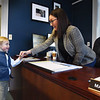 BRYAN EATON/Staff Photo. Four year-old Olivier Egmont of Amesbury is greeted by Amesbury Mayor Kassandra Gove. The youngster's mother, Andrea, campaigned for Gove taking Oliver along on some events. When she won the election he said he wanted to meet with her and ask some questions. He asked about what's being done to keep the parks clean and had issues about litter of the lakes and streams. He also had concerns about people going without certain needs, including children needing toys. She assured him that the town has people working on all of those issues and thanked him for his concerns.