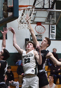 BRYAN EATON/Staff photo. Rockport's Gavyn Hillier tries to block a shot by Kenny Lee.