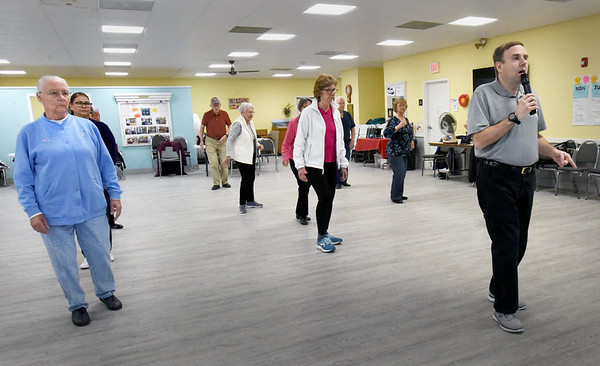 BRYAN EATON/Staff Photo. Jason McCollin, right, leads a line dancing class at the Hilton Senior Center in Salisbury on Tuesday and also does on Thursdays. The classes are just one of several excercise-oriented classes throughout the week.