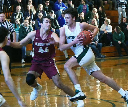 BRYAN EATON/Staff Photo. Parker McLaren guards a Pentucket player as he moves down court.