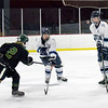 BRYAN EATON/Staff photo. Pentucket's Cam Smith shoots at the Triton net past two defensemen.