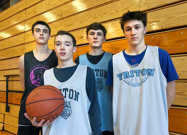 BRYAN EATON/Staff photo. Triton boys basketball players, from left, Michael Farago, TJ Overbaugh, Quintin McHale and Mason Ferrick.