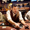 BRYAN EATON/Staff Photo. Dealer Tim Schmitt at one of the poker tables at The Brook gambling parlor in Seabrook.
