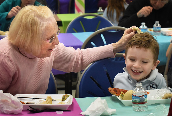 BRYAN EATON/Staff Photo. Patricia Brunje, from N.J. gets a smile from her nephew James Grayson, 5, of Amesbury at the Immaculate Conception School's VIP Luncheon, part of Catholic Schools Week. His grandparents Linda and Avery Grayson and Al Spooner were also his guests for salad, pizza, lasagna and cookies.