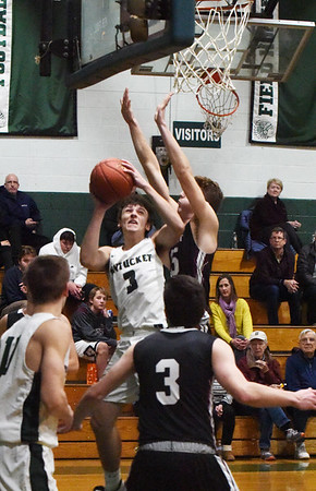 BRYAN EATON/Staff photo. Peter Cleary tries for two as Rockport's Benan Murdock covers.