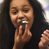 BRYAN EATON/Staff Photo. Natelia Ortiz, 10, couldn't wait to dig in to her cupcake after the judging was complete.