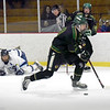 BRYAN EATON/Staff photo. Pentucket's Nolan Cole moves the puck into Triton territory.