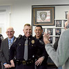 BRYAN EATON/Staff Photo. Former and active police (including former Amesbury police chief Mark Gagnon, back to camera) friends and family gathered to see Amesbury Police Sgt. Rick Poulin, center, on his last day of duty as he's retiring.