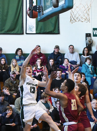 BRYAN EATON/Staff Photo. Pentucket's Silas Bucco tries for two as Newburyport's Trevor Ward covers.