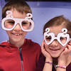BRYAN EATON/Staff Photo. Hunter Gauthier, 8, and sister Riley, 6, show off the 2020 glasses they made during the craft time of the Noon Year's Eve Party at the Amesbury Public Library.