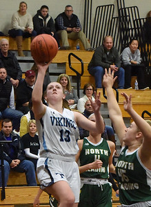 BRYAN EATON/Staff photo. Triton tri-captain lays up for two points against North Reading.