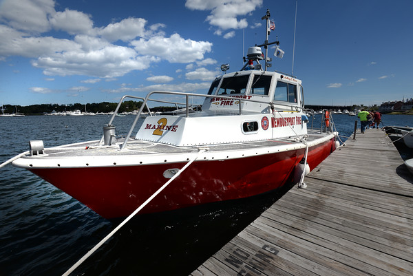 BRYAN EATON/Staff photo. Newburyport Fire Department's fire boat has a new coat of bright paint.