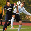 BRYAN EATON/Staff photo. Triton's Ross Lojek battles with a Hamilton-Wenham player for the ball.