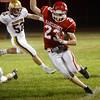 BRYAN EATON/Staff Photo. Masconomet's Scott Foden stays inbounds while gaining a few yards.