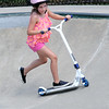 JIM VAIKNORAS/staff photo  Elise Gunther,6, of Swampscott does tricks on her razor scooter at the Newburyport skate park Monday.