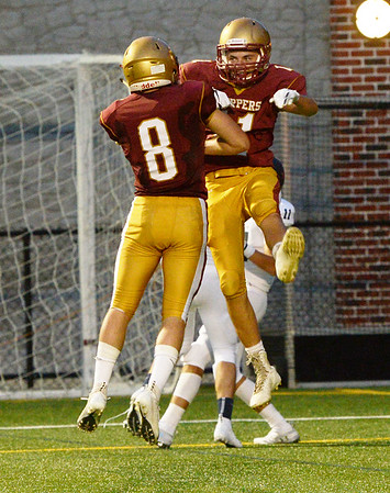 CARL RUSSO/staff photo. NEWBURYPORT NEWS: Newburyport's captain Robert Johnston, left celebrates with his teammate Charles Cahalane after Cahalane scored the second touchdown of the game in football action. 9/7/2018