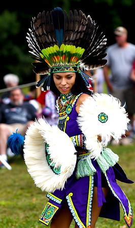 JIM VAIKNORAS/Staff photo Third Word T'Karima dances with the Kalpulli Huehuetllolli Aztec during the annual Inter-Tribal Pow Wow at Plug Pond in Haverhill Saturday.