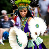 JIM VAIKNORAS/Staff photo Third Word T'Karima dances with the Kalpulli Huehuetllolli Aztec during the annual Inter-Tribal Pow Wow at Plug Pond in Haverhill Saturday.