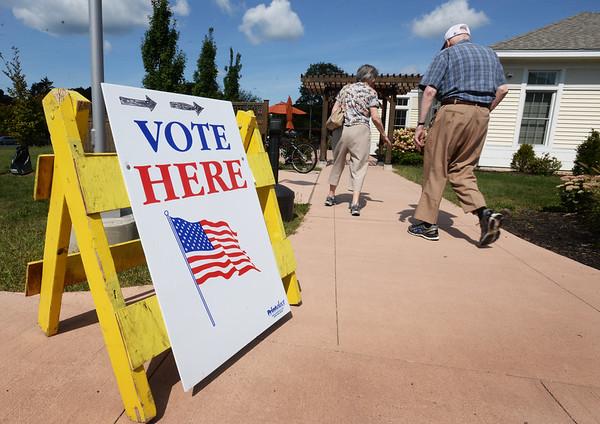 BRYAN EATON/Staff photo. Voters head into Newburyport precincts five and six at the Newburyport Senior Center on Tuesday morning.
