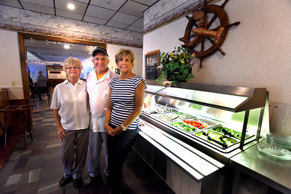 BRYAN EATON/Staff photo. Even though the Hungry Traveler in Salisbury is for sale, the owners want the public to know they're still open. At the salad bar, from left, Sophia Cameron, Gary Cameron and Donna Rignoli.