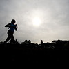 JIM VAIKNORAS/Staff photo A runner in the Clipper Relay at Maudslay State Park finishes the race under cloudy skies Saturday.