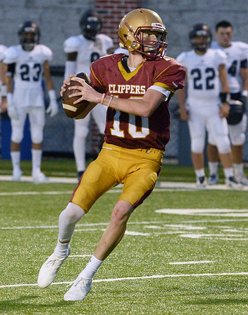 CARL RUSSO/staff photo. NEWBURYPORT NEWS: Newburyport's quarterback Thomas Murphy looks to pass in football action. 9/7/2018