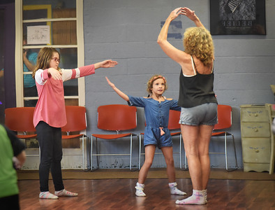 """BRYAN EATON/Staff photo. Alexis Smith, 11, left, and  Evelyn Phair, 6, have their eyes on dance instructor Samantha Stanton at the Boys and Girls Club in Salisbury in their first lesson of ballet. Stanton has been teaching at the club for several years forming the girls group """"The Believers"""" and boys group """"The Maple Street Boys"""" which perform in-house and at the Salisbury Senior Center as they progress."""
