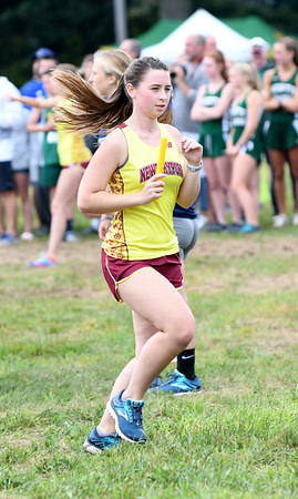 JIM VAIKNORAS/Staff photo Newburyport's Lila Piaguad at the Clipper Relay at Maudslay State Park Saturday.