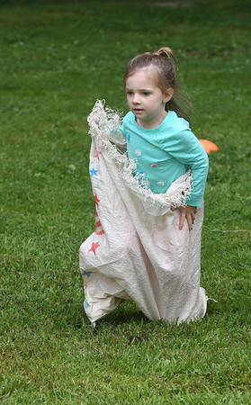 JIM VAIKNORAS/Staff photo Emmi McGrath, 4, competes in teh sack race Saturday at the Amesbury 250th Town Picnic at Amesbury Town Park.