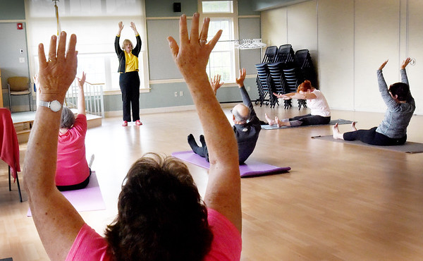 BRYAN EATON/Staff photo. Mary van Abs of Newburyport leads yoga class at the Newburyport Senior Center every Thursday afternoon. Her focus is on teaching her students (of any age) how to maintain or re-claim their bodies through gentle stretching, breathing and meditation.