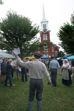 JIM VAIKNORAS/Staff photo Town Crier Stuart Proctor call the people to order at the Central Congregational Church 250th anniversary celebration in Brown Square in Newburyport Saturday. The event included, story telling, a sing along, cutout photo props, kids crafts and games, along with beer , cider and mead.