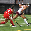 JIM VAIKNORAS/Staff photo Newburyport's Alex Sirek has the ball knocked away from her by Masconomet's Ava Tello during their game at Newburyport High School Thursday night.