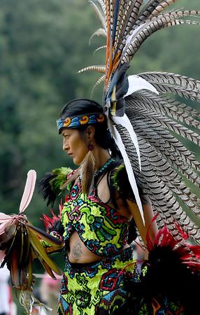 JIM VAIKNORAS/Staff photo Second Word  Quetziquela Jaramello dances with the Kalpulli Huehuetllolli Aztec during the annual Inter-Tribal Pow Wow at Plug Pond in Haverhill Saturday.