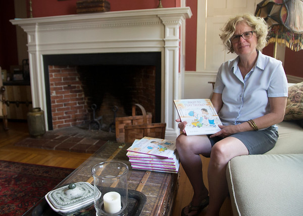 "JIM VAIKNORAS/Staff photo Newburyport resident Ann Stott at her home. She has written a children's book called ""Want to Play Trucks"" based on a friendship her son struck up with another young boy in a local park some 14 years ago."