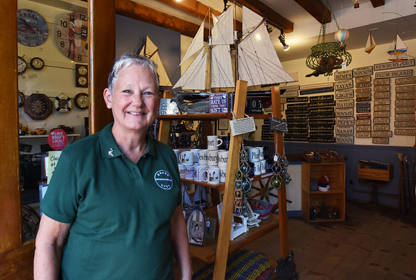 BRYAN EATON/Staff photo. After buying the Brass Lyons from original owner Steve Lyons 12 years ago, Diane Gronbeck and husband Ed are selling the business on Inn Street in Newburyport.
