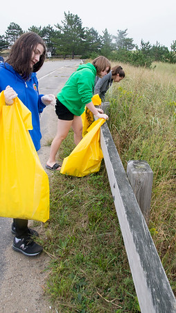 JIM VAIKNORAS/Staff photo Jennifer Cook  of Amesbury, Cassandra Clark, of Haverhill, and Olivia Murdack of Methuen clean up during the 31st annual Clean Sweap at Salisbury Beach Saturday. Over 150 people participated in the event at the Reservation, the event was also held on other beaches in the state.