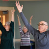 BRYAN EATON/Staff photo. Retired pharmacist Joseph Fanaras and seven others stretch and do breathing excercises in yoga class at the Newburyport Senior Center. The class, taught by Mary van Abs, meets every Thursday for an hour starting at 2:30 p.m.