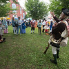 JIM VAIKNORAS/Staff photo Story Teller Mike Welch spins a yarn of colonial times at the Central Congregational Church 250th anniversary celebration in Brown Square in Newburyport Saturday. The event included, a sing along, cutout photo props, kids crafts and games, along with beer , cider and mead.