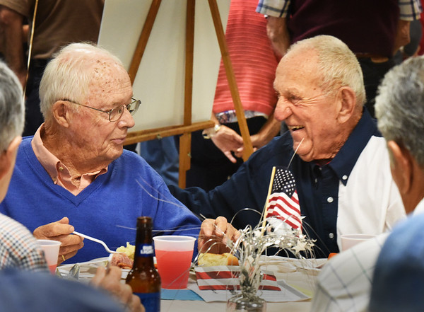 """BRYAN EATON/Staff photo. World War II veterans Jere Doyle of Newburyport, left, and Robert """"Boots"""" Chouinard of Salisbury chat at a veterans luncheon at the Elks Lodge 909 of Newburyport on Friday in honor of POW/MIA Recognition Day. The luncheon was sponsored by the Elks and the local chapter of Disabled American Veterans."""