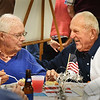 "BRYAN EATON/Staff photo. World War II veterans Jere Doyle of Newburyport, left, and Robert ""Boots"" Chouinard of Salisbury chat at a veterans luncheon at the Elks Lodge 909 of Newburyport on Friday in honor of POW/MIA Recognition Day. The luncheon was sponsored by the Elks and the local chapter of Disabled American Veterans."