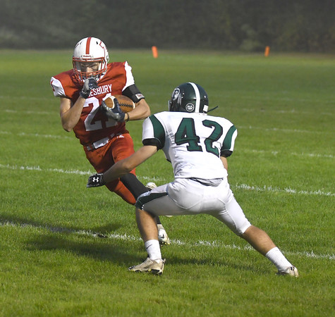 JIM VAIKNORAS/Staff photo Amesbury's jacob Robinson makes a move against Pentucket at Landry Stadium in Amesbury Friday.